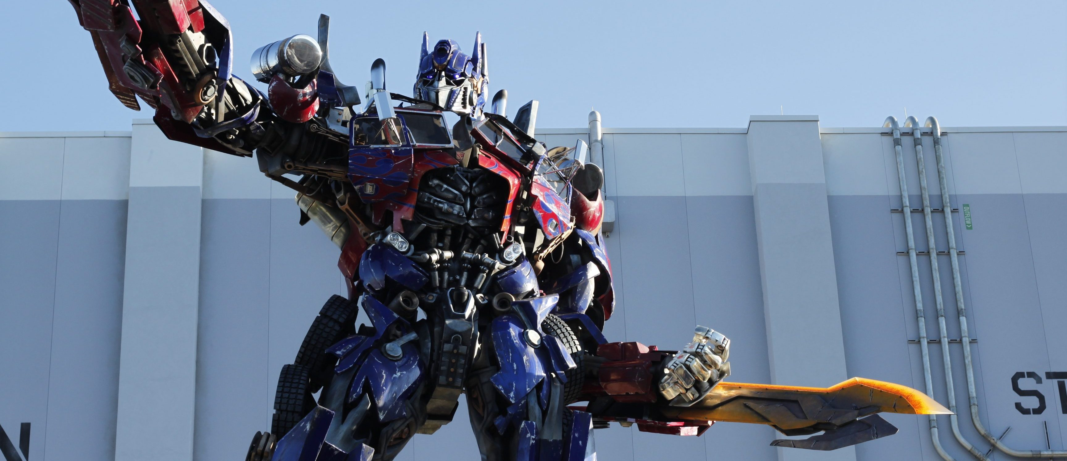 optimus prime with sword pointing out