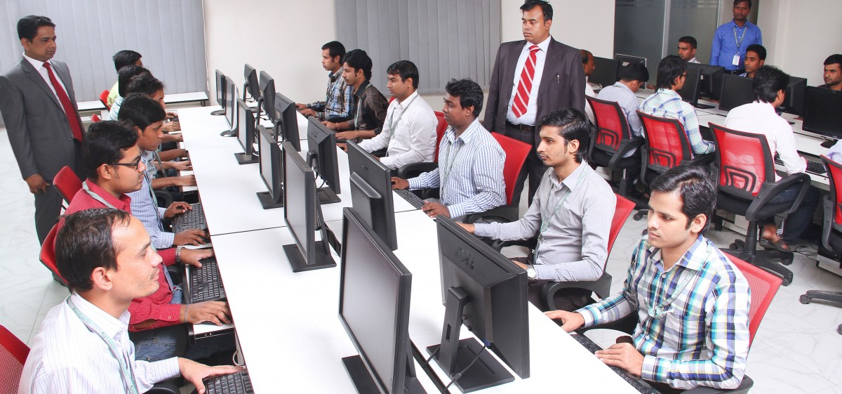 Team of Indian developers and managers working in an open office concept