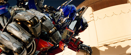 Optimus prime with his hand clenched article banner for manual vs automated business processes