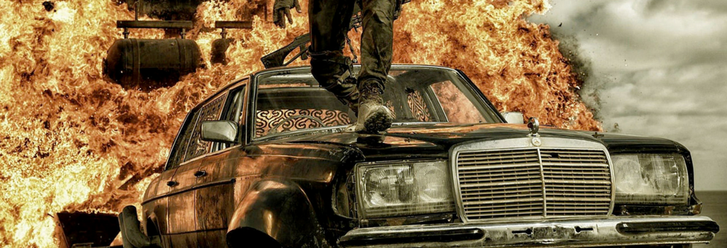 Article banner a man walking on a car and explosion behind