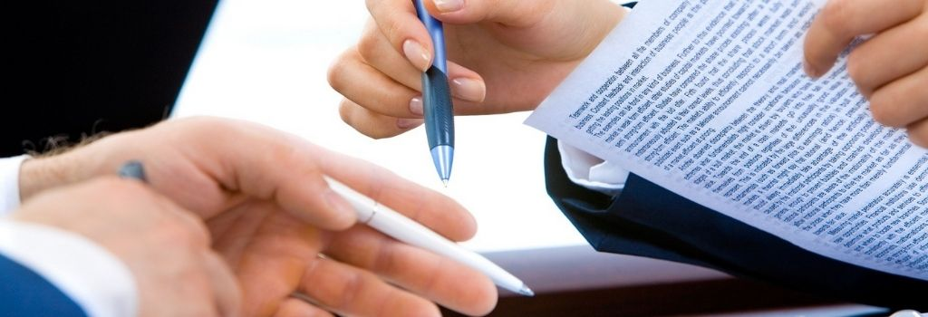 two people reviewing a contract or document